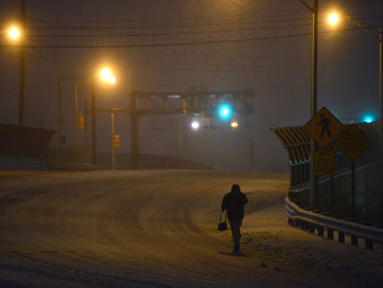 6:09AM A man walks on Paterson Plank Rd over Route