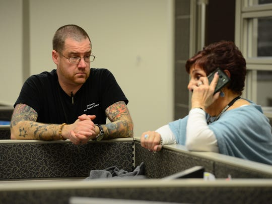 Ben Kimmel, a recovery specialist, and Sue A. Marchese-Debiak, of Bergen County Health Services, encourage a person on the phone to seek help with drug addiction.