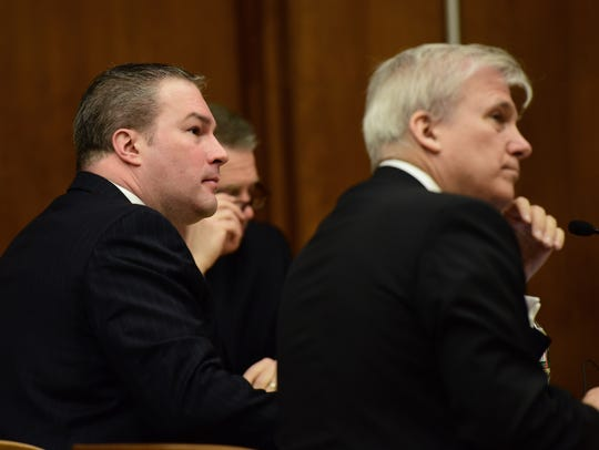 Daniel Rochat, left, with his attorneys Jim Doyle and