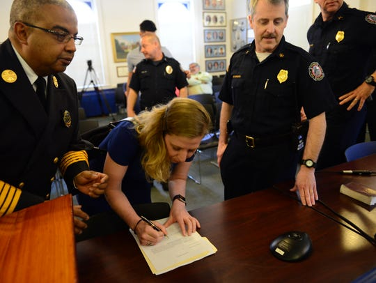 Ashley Hahn, of Teaneck, signs the Oath of Office as