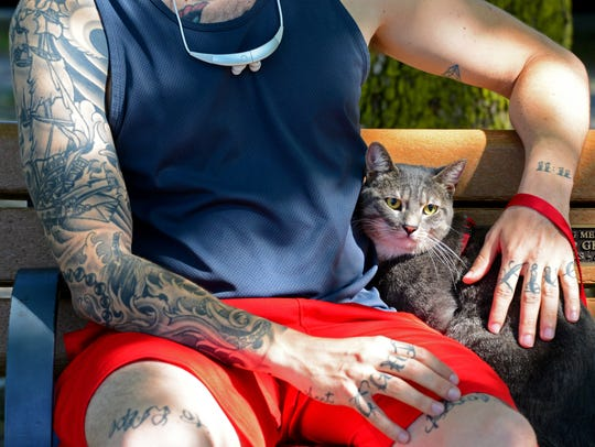 Tom Purdy of Elmwood Park took his 2-year-old cat,
