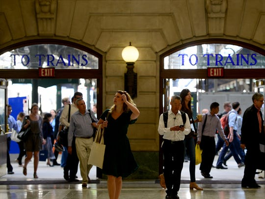 Commuters make their way through Hoboken Terminal.
