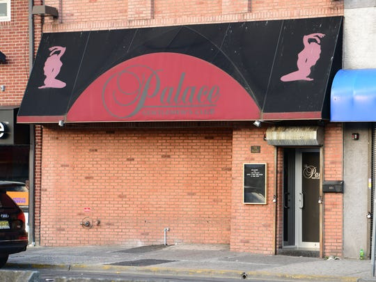 A man was shot and two others stabbed outside The Palace, a gentleman's club, in the early morning hours on Wednesday.