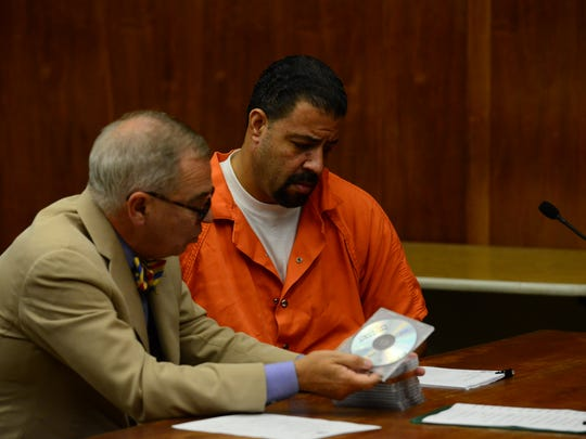 Raphael Lolos, accused of murdering and dismembering his girlfriend, goes over files with his attorney Brian J. Neary during the adjournment of his detention hearing before Judge Jerejian Wednesday morning.
