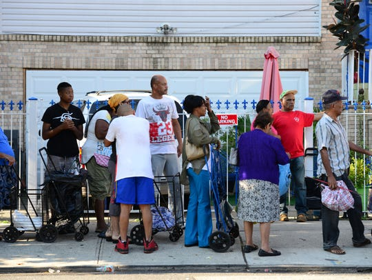 Paterson residents line up for food distribution at