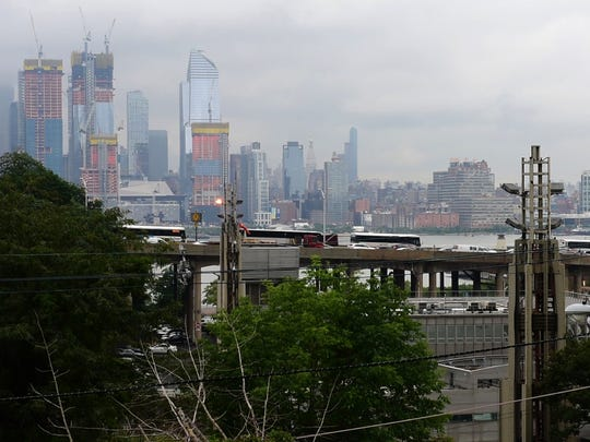 "Konstantinos Natsis boasts of the ""million-dollar view"" from his farm overlooking the Lincoln Tunnel helix."