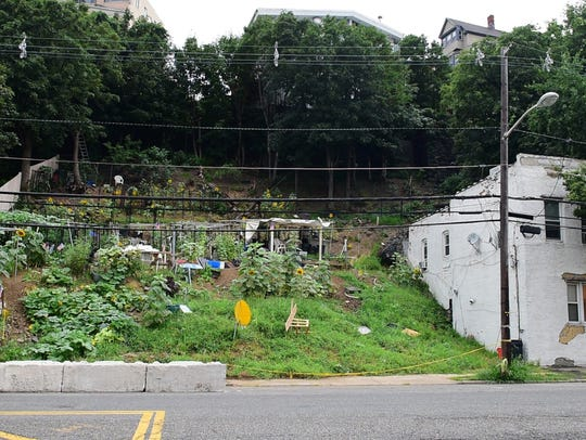 The farm in Weehawken is dug into the steep slope of