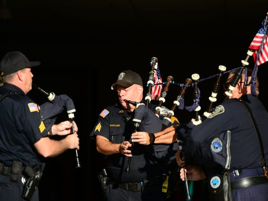 """From left, Teaneck police Sgts. Paul Finkler and Jack Garland and Capt. Kenneth Croonquist rehearse """"Amazing Grace"""" on their bagpipes before the 9/11 ceremony at the municipal parking lot Monday morning."""