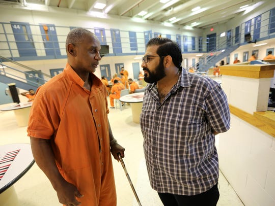 Imam Mohammed Ibn Ahmed chats with an inmate, Marvin