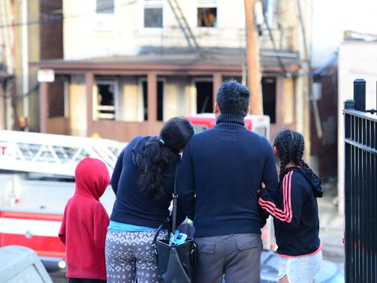 A family from an adjacent building who were evacuated