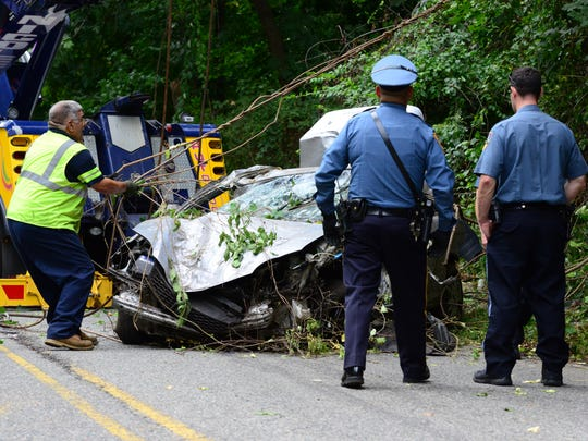 A car drove into the woods last night and was only discovered and removed around noon today along Riverview Dr in Totowa, September 20th, 2017. The car left Route 80 just before the Passaic River Bridge and went down the embankment causing heavy damage to the Honda Civic coupe. A heavy duty tow truck was called to the scene to lift the car out of the wooded area.