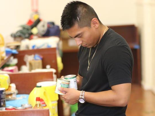 Juan Carlos Cinto, 24, of Passaic looks for expiration
