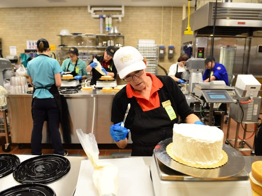 Cakes are getting covered with icing at Wegmans, which