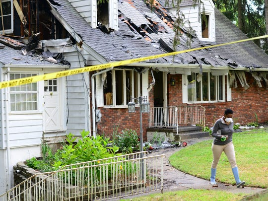 Betty Adams, the home owner walks away from her burned