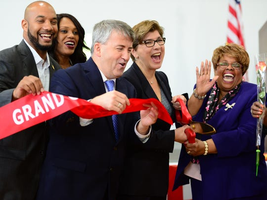 From left, T.J. Best, Passaic County Freeholder, Nihat Guvercin, iLearn School CEO, Nellie Pou, NJ State Senator, and Jane Williams Warren, Paterson Mayor, at the ribbon cutting ceremony. iLearn Schools held its Grand Opening today at a newly refurbished mill in Paterson that is new home for the Paterson Arts and Science charter school.