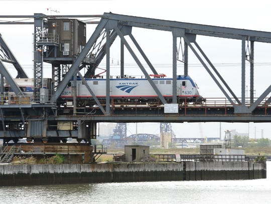 An Amtrak train crosses the swing bridge that will