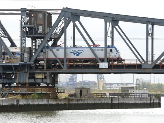 An Amtrak train crosses the swing bridge that will be replaced on the Hackensack River. The Portal North Bridge Project is a critical component of the Gateway Program – a comprehensive rail investment program designed to add critical resiliency and create new capacity on the 10-mile stretch of the Northeast Corridor between Newark, N.J. and Penn Station New York.