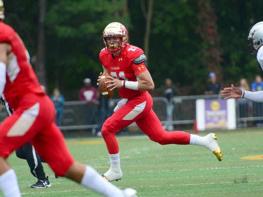 Johnny Langan, quarterback for Bergen Catholic, looks down field to pass in the second quarter. Bergen Catholic vs St. Peter's Prep High School Football game on Saturday, October 14th, 2017.