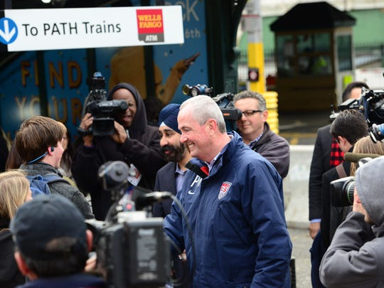 Governor-elect Phil Murphy greets commuters at the Hoboken PATH Station on Wednesday morning with Hoboken Mayor-elect Ravi Bhalla.
