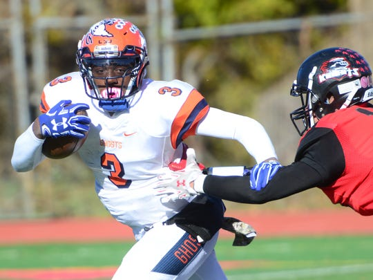 At left, Lamar Johnson, of Eastside, tries to run around Diony Dilone, of Kennedy, during the annual Thanksgiving Day high school football game between Kennedy and Eastside in Paterson.
