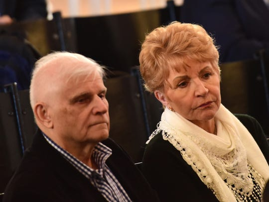 Tad and Elizabeth Hrymoc watch the opening statements