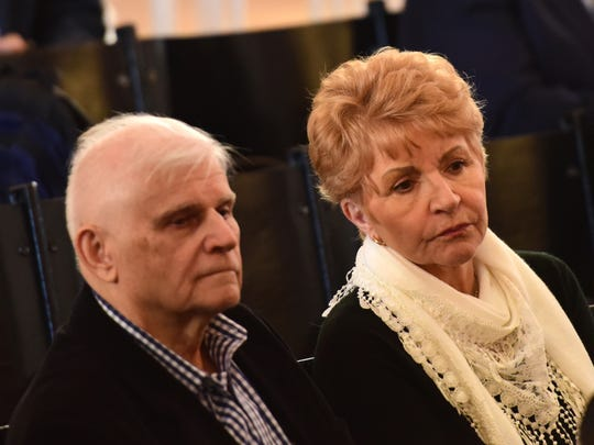 Tad and Elizabeth Hrymoc watch the opening statements during their court case against Ethicon, which they say manufactured and distributed a faulty medical device, at the Bergen County Courthouse before Judge Rachelle L. Harz on Monday.