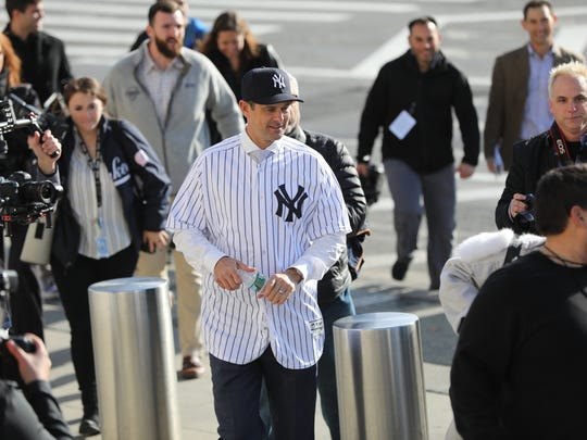 New Yankees manager, Aaron Boone is surrounded by the press outside Yankee Stadium, Wednesday, December 6, 2017.