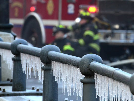 Icicles form at the scene of a 2nd Alarm fire at a