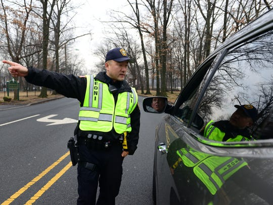Leonia Police Officer Sihoon Chung explains to a driver