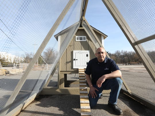 Urban homesteader, Victor Alfieri, is alongside a chicken coop and run at Gro-Rite Garden Center in Lincoln Park, on Tuesday Feb. 13, 2018.
