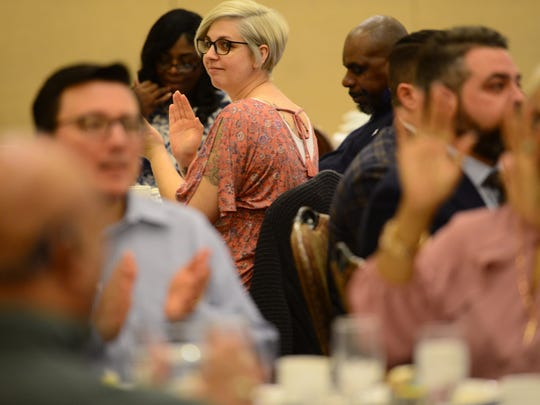 Josephine Cornacchia, a recovery specialist with Eva's Village, applauds during the Community Partnership Award luncheon sponsored by Mutual of America at the Marriott in Saddle Brook on Monday March 12, 2018.