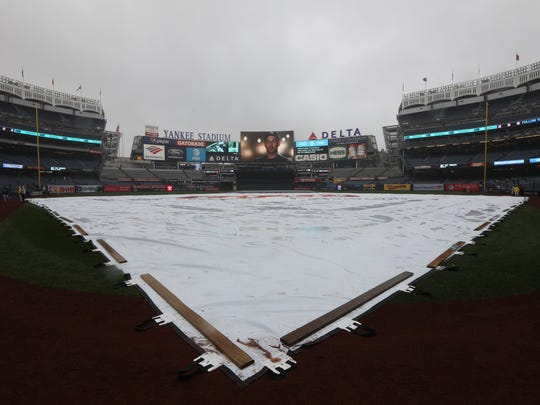Rain is falling at Yankee Stadium as fans hope to see