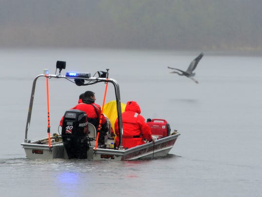 A Wallington Emergency Squad boat search the water for a body at Barbour Pond at Garret Mountain Park in Woodland Park on Wednesday April 25, 2018.