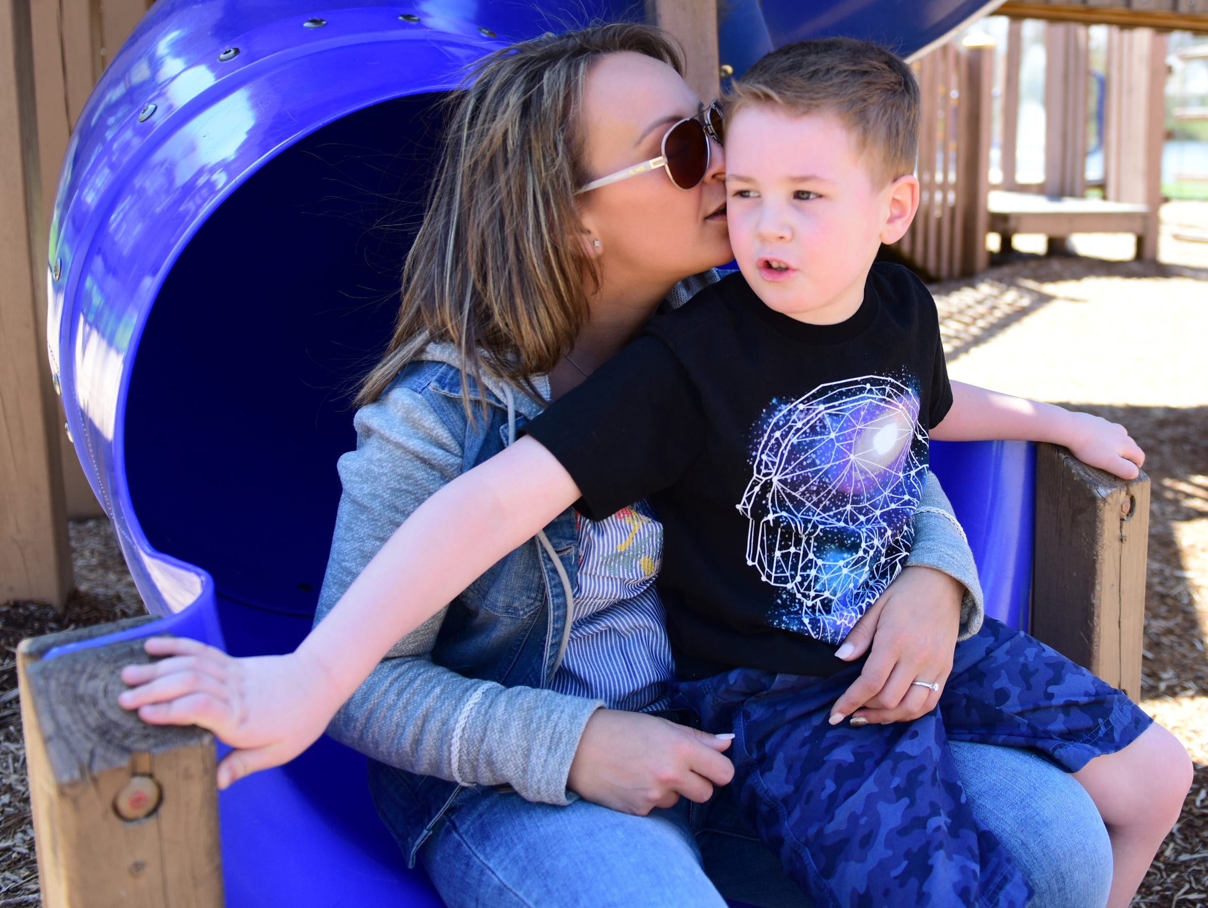 Amanda Zita, 28, plays in the park with her son, Mason,