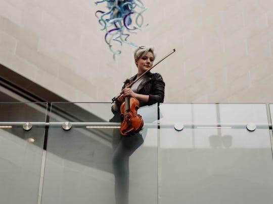 Hanna Landrum in the Hatch Hall Wolk Atrium.