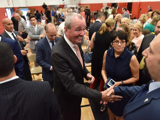 New Jersey Governor Phil Murphy greets guests after