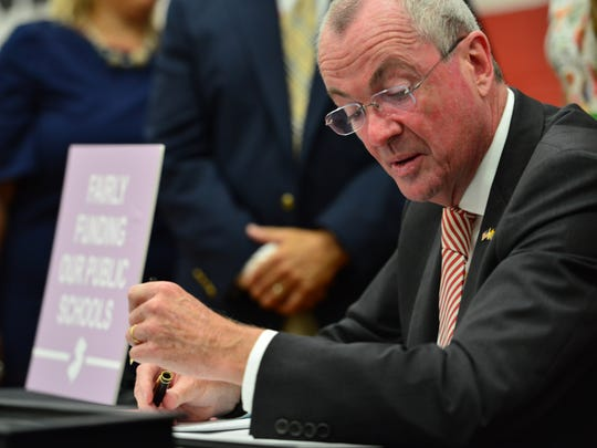 New Jersey Governor Phil Murphy signs school funding