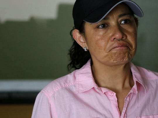 Marina Rodas, got emotional as she explains the terror of Thursday morning when she noticed water inside her Fairview apartment. After damage to the apartments at 570 Fairview Ave. during a rain storm, when rocks from cliffs to the east came slamming into the buildings, early Thursday morning, damage continued Saturday morning.  A retaining wall to the apartment building's parking lot collapsed, causing serious damage to homes on Linda Lane Sunday, Aug. 12, 2018.