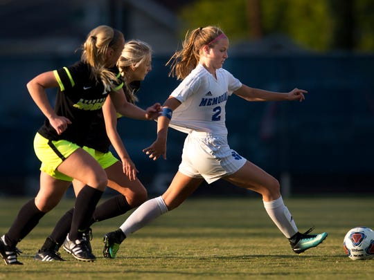 Memorial's Isabel Alexander (2) gets a jersey tug from
