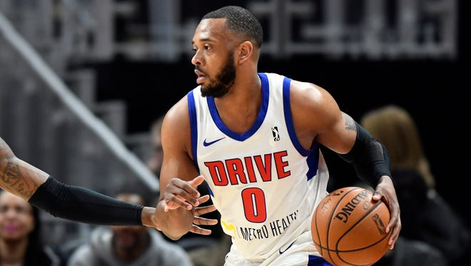 Grand Rapids Drive forward Zeke Upshaw looks to pass during a basketball game in Detroit.