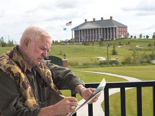 Photo of Terry Redlin on Redlin Art Center grounds.