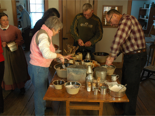 Participants prepare their hearth-cooked meal with their own hands in the Wade House stagecoach hotel.