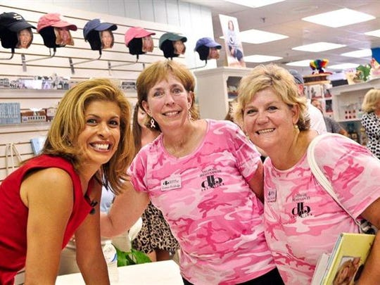 Staff members Connie Holdridge (center) and Cheryl Doucette (right) meet Hoda Kotb of the Today Show when she was signing books at Browseabout Books in Rehoboth Beach in 2011.