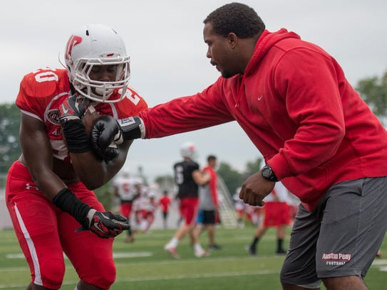 Austin Peay running back Prince Momodu practices for