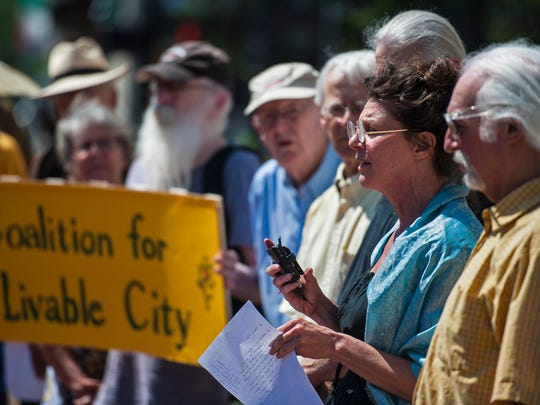 Genes Grill, right, of The Coalition for a Livable City, who are opponents of the proposed Burlington Town Center redevelopment plan, speaks during a news conference in front of City Hall in Burlington on Wednesday, July 6, 2016.  The city's planning commission will be considering the issue Wednesday evening.