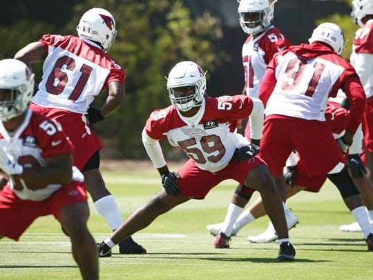 Arizona Cardinals linebacker Vontarrius Dora (59) during