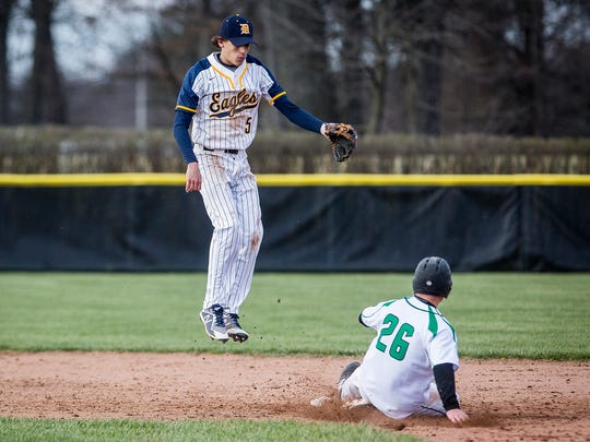 Delta's Aiden Hinds jumps for a throw during a doubleheader