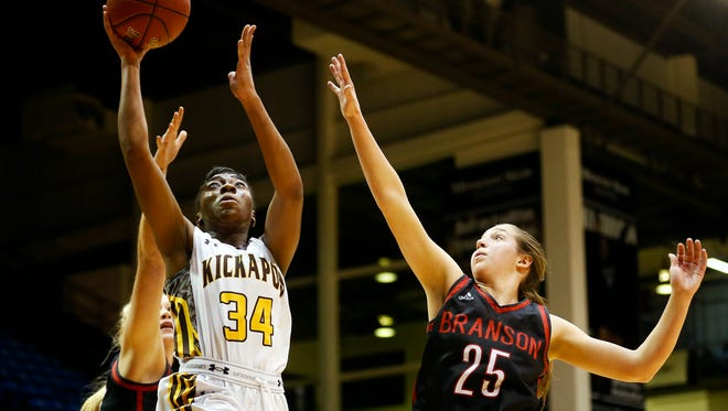 Kickapoo High School senior Jordan Sanders (34) goes up for a shot as Branson Pirates guard Lauren Garrison (25) tris to defend her during first quarter action of the MSHSAA Class 5 District 11 championship playoff game between the Kickapoo Chiefs and the Branson Pirates at Hammons Student Center in Springfield, Mo. on March 2, 2017. The Pirates won the game 58-54.