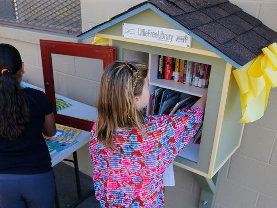 "Young patron takes advantage of a ""Little Library"""