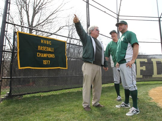 Joe Brennen, left, and Jim Roach, center both members of the 1977 HVBC Championship team gather with head coach Kory Van Zandt near home plate prior to a commemorative ceremony prior to a varsity baseball game against North Rockland at FDR High School in Hyde Park on Saturday, April 15, 2017.